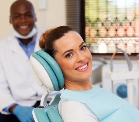 beautiful woman at the dentist office and ready for checkup